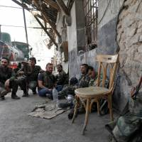 Syrian army tightens noose around Islamic State-held Palestinian camp in Damascus
