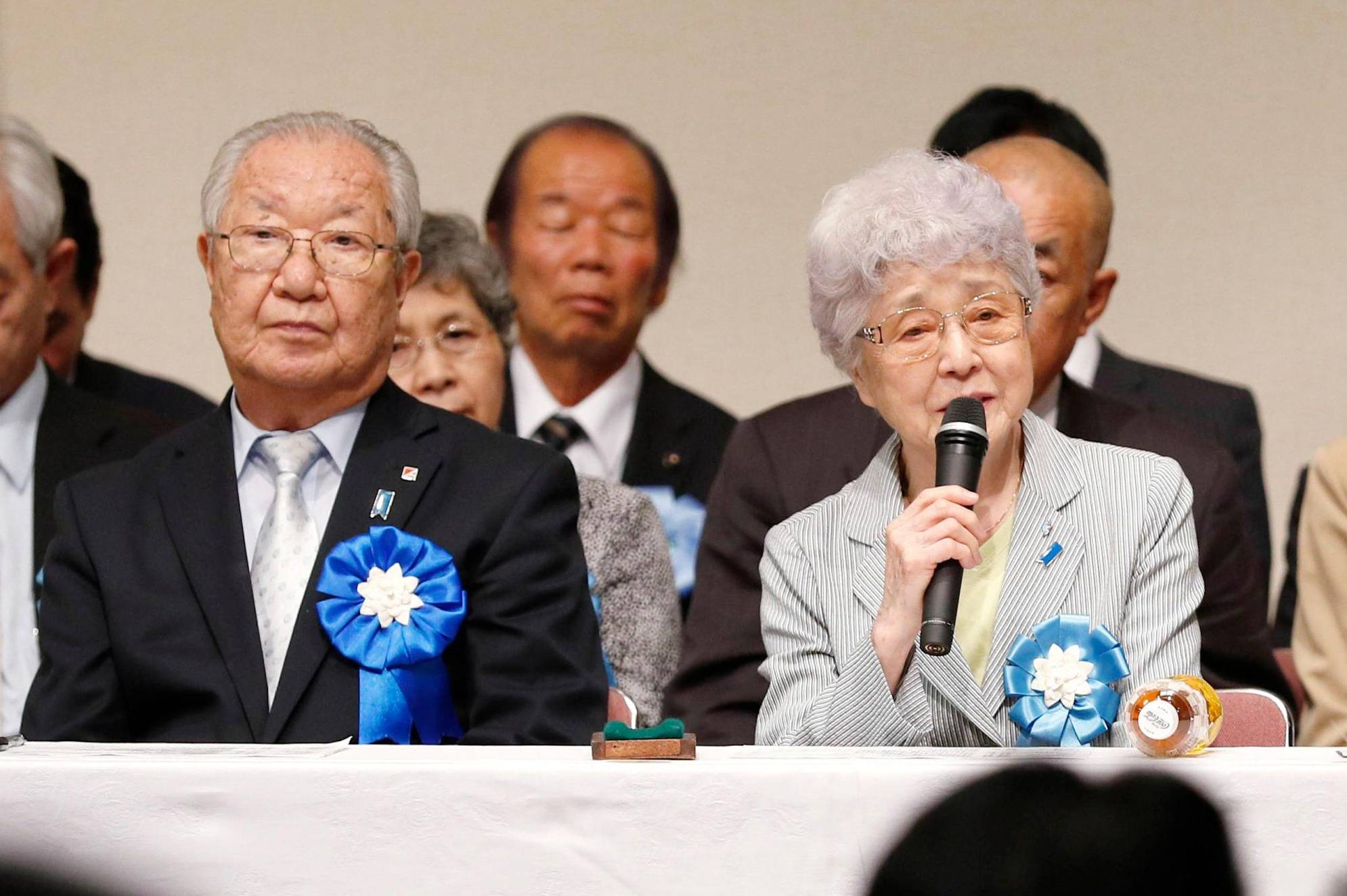 Sakie Yokota (right), the 82-year-old mother of Megumi, who was abducted in 1977, speaks during an event focusing on Japanese nationals abducted to North Korea on April 22 in Tokyo's Chiyoda Ward as Shigeo Iizuka, who heads a group representing abductees' families, looks on. | KYODO