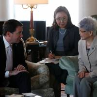 Sakie Yokota (right), mother of Megumi Yokota, who was abducted by North Korea agents at age 13 in 1977, meets U.S. Ambassador to Japan William Hagerty in Tokyo on Tuesday. | REUTERS