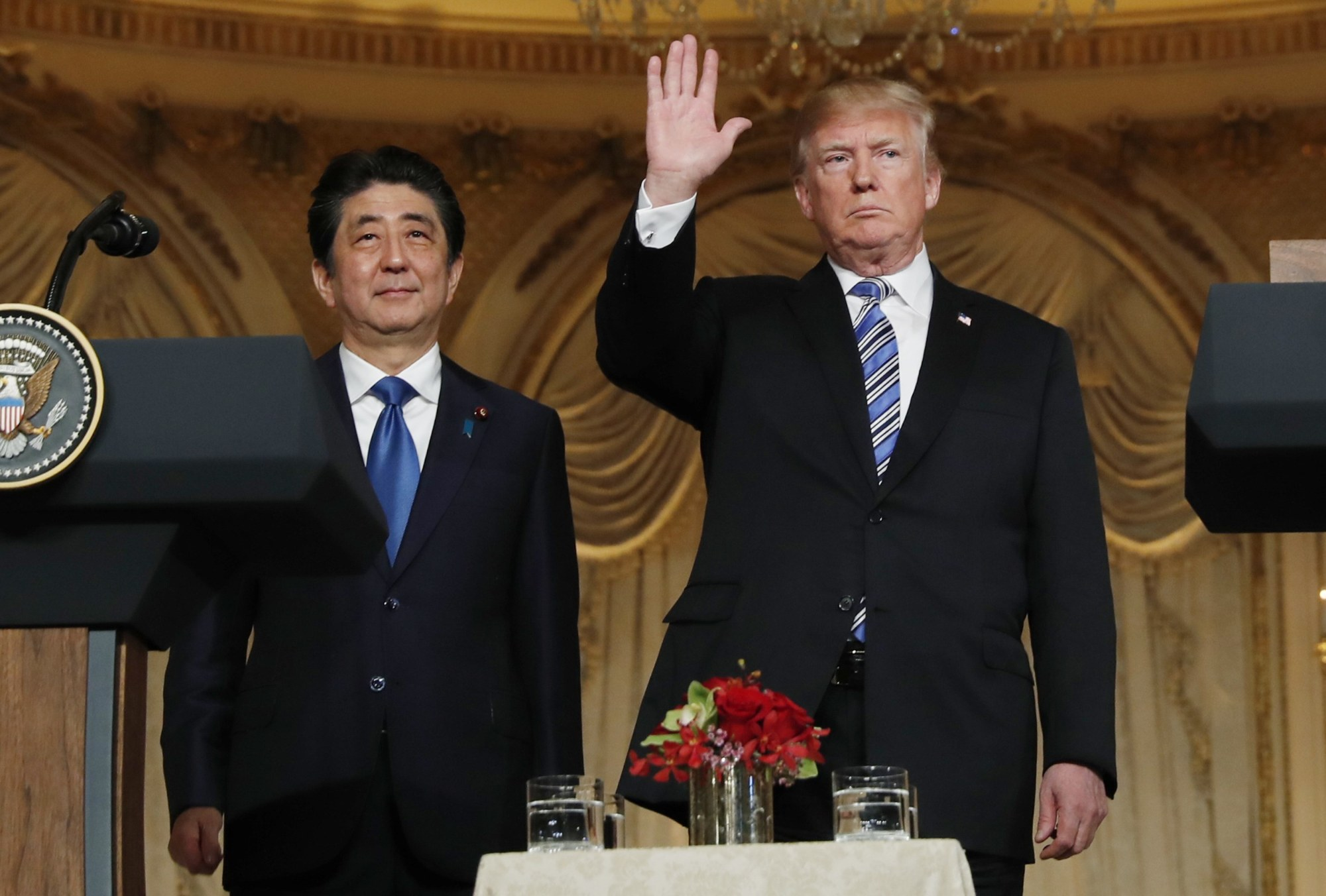 U.S. President Donald Trump waves at the conclusion of a joint news conference with Prime Minister Shinzo Abe at Trump's Mar-a-Lago estate in Palm Beach, Florida, on Wednesday. | REUTERS
