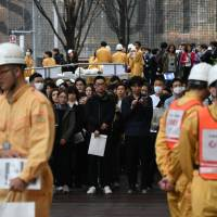 Japan's vaunted quake and missile alert system runs up against limits