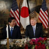 U.S. President Donald Trump and first lady Melania Trump host Japanese Prime Minister Shinzo Abe and his wife Akie Abe for dinner at Trump's private Mar-a-Lago club at his resort in Florida on Wednesday. | AP