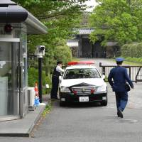 Police officers guard the Imperial Palace's Hanzomon gate in April. | YOSHIAKI MIURA