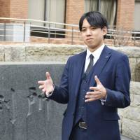 Son of Brazilian migrant set to qualify as lawyer in Japan
