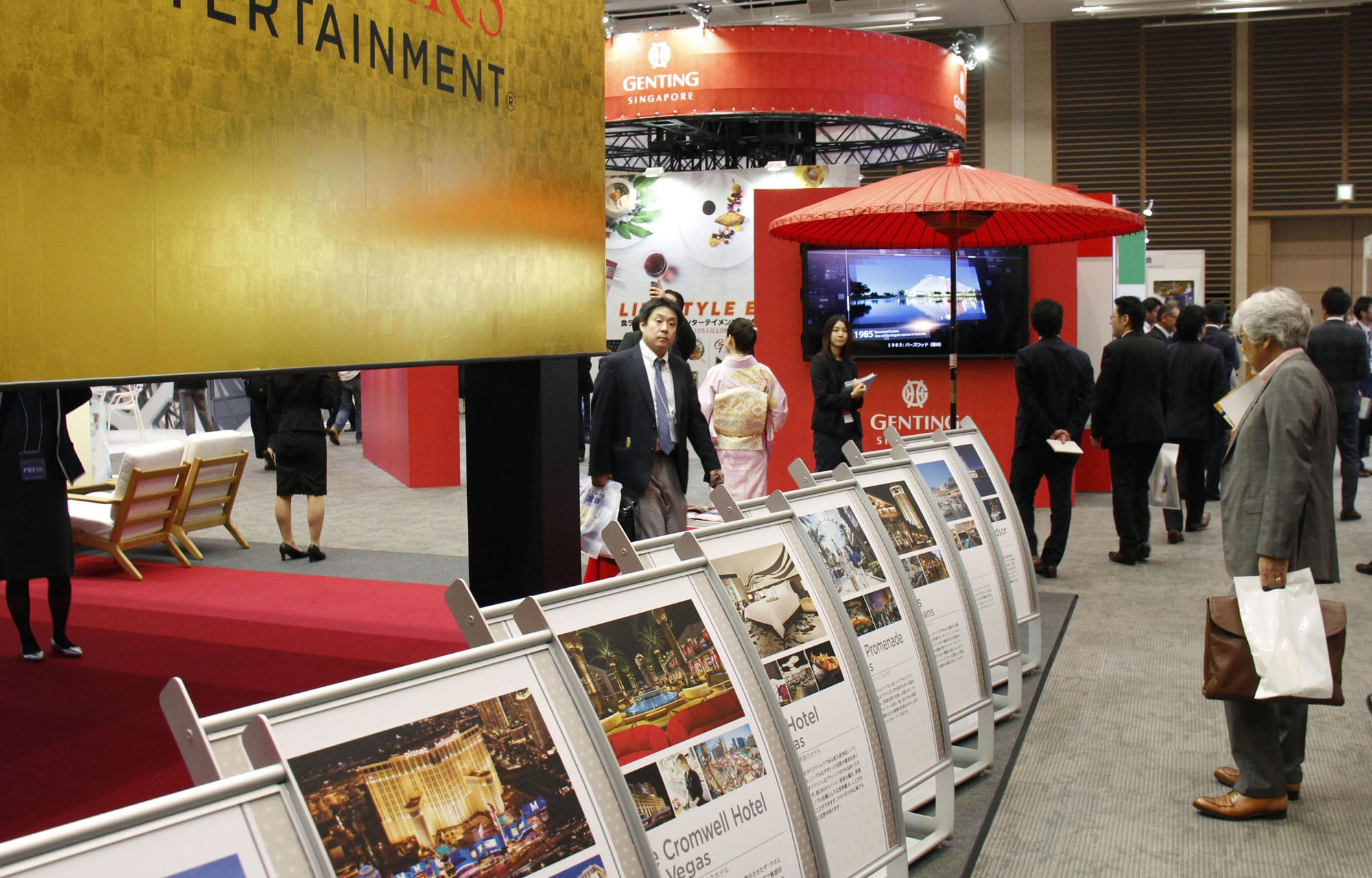 Visitors attend an integrated resorts trade show at Grand Front Osaka on Friday.   KYODO