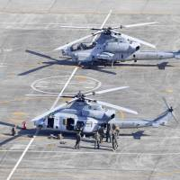 A U.S. military UH-1 helicopter (front) made an emergency landing at Kumamoto Airport on Wednesday. | KYODO