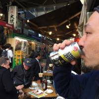 Shigehito Inoue sips a can of Suntory's top-selling Strong Zero in Tokyo's Ueno district, in April. Major brewing and distilling companies are betting on chūhai to offset over a decade of shrinking beer sales. | ALEX MARTIN
