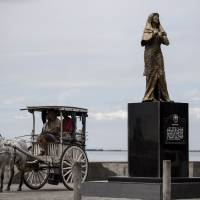 Groups protest as statue honoring WWII 'comfort women' is removed from Manila promenade
