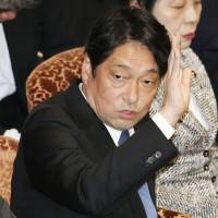 Defense Minister Itsunori Onodera raises his hand to speak at a meeting of the Upper House Audit Committee on Monday. | KYODO