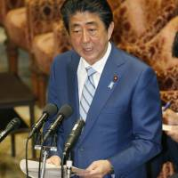 Prime Minister Shinzo Abe speaks at a Lower House Budget Committee session on Thursday. | KYODO