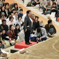 Tomoko Nakagawa, the mayor of Takarazuka, Hyogo Prefecture, makes a speech outside a dohyō (sumo ring) at an exhibition in the city on Friday. Her request to speak form inside the ring was denied by the organizers of the event. | KYODO