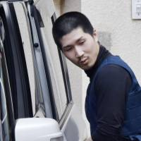 Tatsuma Hirao, who was on the run for about three weeks after escaping from an open prison in Shikoku, is seen after his capture in the city of Hiroshima on Monday. | KYODO