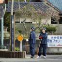 Police search for a prison escapee on Mukaishima Island in the Seto Inland Sea on Sunday. Tatsuma Hirao, 27, remains at large after he escaped on April 8 from a prison in the city of Imabari, Ehime Prefecture.