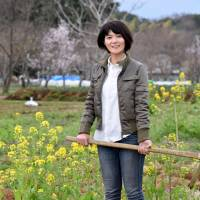 Kiyoko Ojima, who helps homeless and other needy people by giving them opportunities to work in agriculture, is seen at her field in Fujisawa, Kanagawa Prefecture, on March 19. | SATOKO KAWASAKI .