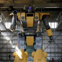 Japanese engineer builds giant robot to realize Gundam dream