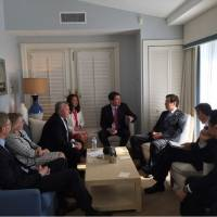 U.S. Ambassador to Japan William Hagerty (center) speaks with Japanese and U.S. officials at Donald Trumps Mar-a-Lago estate in Florida on Wednesday. | U.S. STATE DEPARTMENT