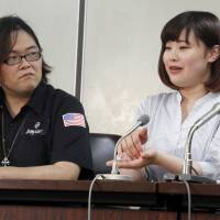 A 20-year-old actress who goes by the name Chino (right) speaks to journalists at the Tokyo District Court's press club on Friday. | AP