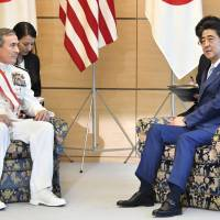 Adm. Harry Harris (left), commander of U.S. Pacific Command, meets Prime Minister Shinzo Abe on Thursday at the Prime Minister's Office. The two agreed to maintain maximum pressure on North Korea to abandon its nuclear and ballistic missile development programs. | KYODO