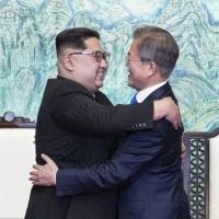 North Korean leader Kim Jong Un and South Korean President Moon Jae-in embrace after signing a joint statement at the border village of Panmunjom in the Demilitarized Zone on Friday. | AP