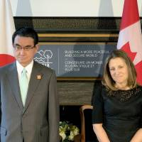 Foreign Minister Taro Kono and his Canadian counterpart Chrystia Freeland pose as they meet to sign a bilateral defense supply-sharing pact in Toronto on Saturday. | KYODO