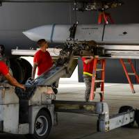 Members of the U.S. Air Force's 96th Aircraft Maintenance Unit upload a JASSM (joint air-to-surface standoff missile) to a MAU-12 ejector rack for a weapons load competition at Barksdale Air Force Base in Louisiana, last July. | U.S. AIR FORCE