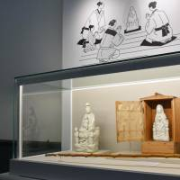 Maria Kannon statues — objects of worship by Christians who had to hide their faith in the Virgin Mary — are displayed at a newly opened museum in Nagasaki on April 1. | KYODO