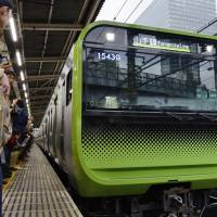 A new Yamanote Line train model is seen at Osaki Station in March 2016 in Tokyo. | KYODO