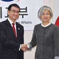 Foreign Minister Taro Kono and his South Korean counterpart, Kang Kyung-wha, pose for a photo Wednesday before holding bilateral talks in Seoul. | KYODO