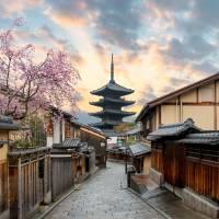 Yasaka Pagoda and Sannen Zaka Street with cherry blossom in Kyoto. | GETTY IMAGES