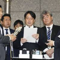 Defense Minister Itsunori Onodera speaks to reporters after disclosing daily activity logs for a past Ground Self-Defense Force mission in Iraq on Monday. | KYODO