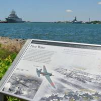 A plaque in Honolulu carries information about the Japanese attack on Pearl Harbor. On Wednesday, a group of U.S. and Japanese researchers plan to visit the site in Papua New Guinea where American fighters shot down a Japanese bomber carrying Admiral Isoroku Yamamoto, the mastermind of the Pearl Harbor attack. | KYODO