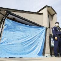 Teenage officer arrested after colleague found shot to death in Shiga police box
