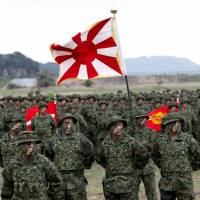 Troops from the Ground Self-Defense Force's Amphibious Rapid Deployment Brigade, Japan's first marine unit since World War II, gather at a kickoff ceremony at the GSDF's Camp Ainoura in Sasebo, Nagasaki Prefecture, on Saturday. | REUTERS