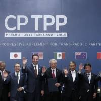 Leaders pose for an official photo after signing the rebranded 11-nation trade pact, the  Comprehensive and Progressive Agreement for Trans-Pacific Partnership (CPTPP), in Santiago on March 8.   AFP-JIJI