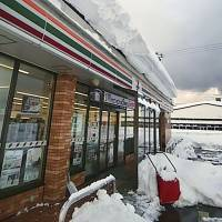 The owner of the Seven-Eleven store in Fukui Prefecture in this photo provided by a labor union was allegedly forced to work for about 50 hours during a blizzard in February. | KYODO