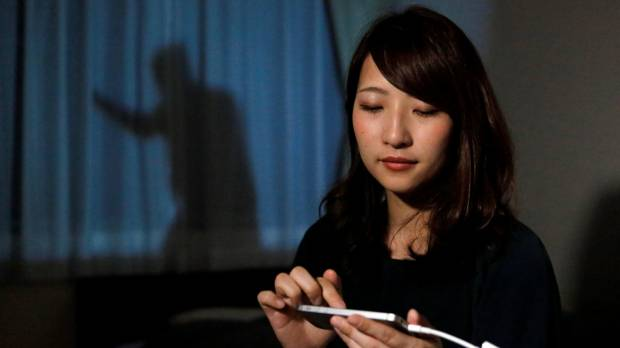 Shadowy 'Man on the Curtain' projection aims to protect home-alone women in Japan
