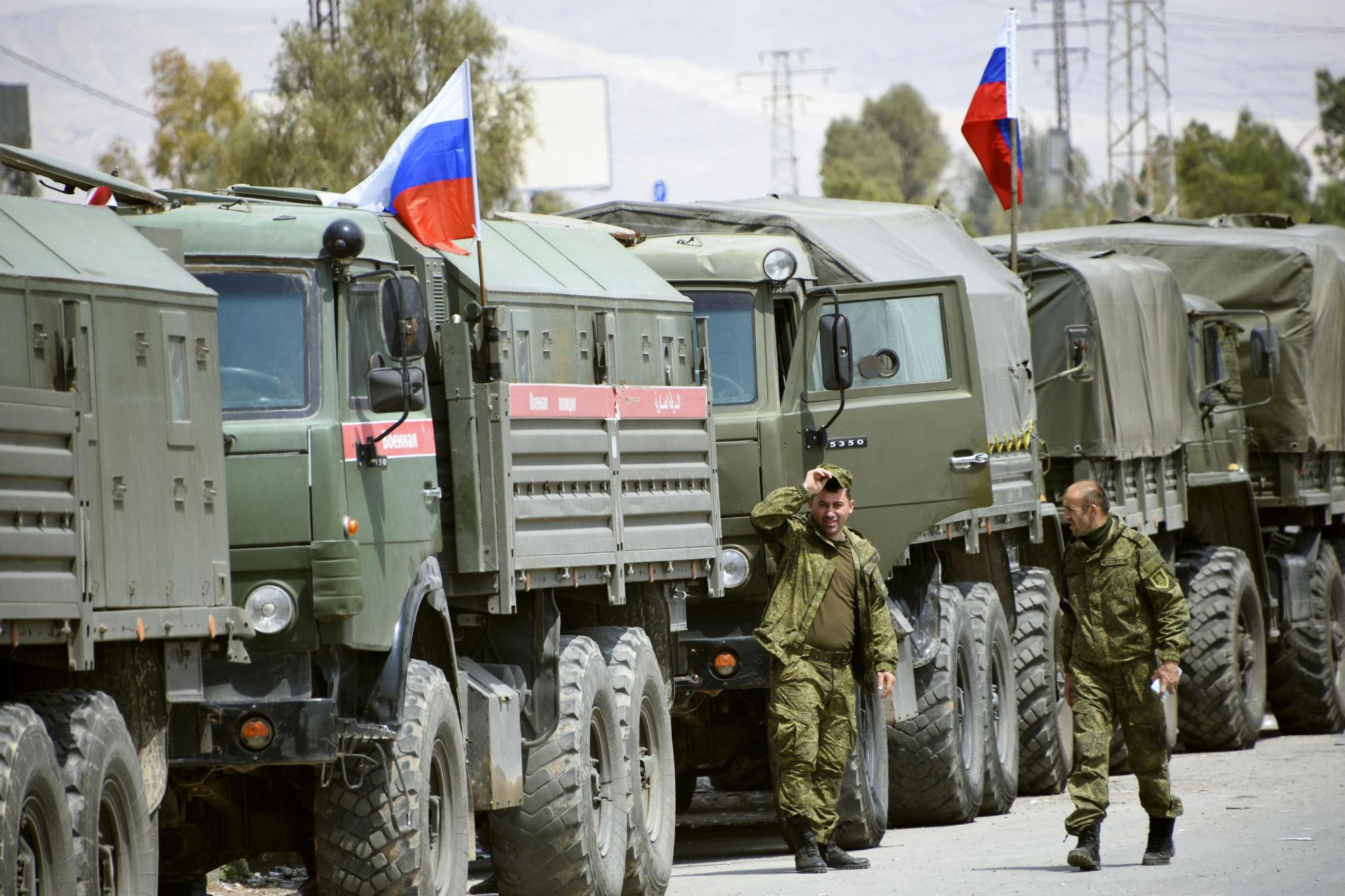 Russian military police officers stationed in the eastern Ghouta near Damascus, in Syria, are seen on Thursday. | KYODO