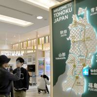 A panel highlighting prefectures in the Tohoku region is seen at Sendai Airport in April last year. | KYODO