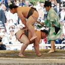 Sumo wrestlers perform during an annual sumo tournament dedicated to the Yasukuni Shrine in Tokyo on April 16.