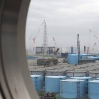 Storage tanks for contaminated water stand at the Fukushima No. 1 nuclear plant in February 2017. More than seven years after the world's worst nuclear accident since Chernobyl, Tepco still faces massive compensation lawsuits filed by people whose livelihoods were destroyed. | BLOOMBERG