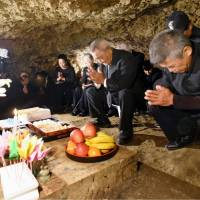 Memorial service held in Okinawa cave to remember 83 villagers who committed mass suicide in 1945