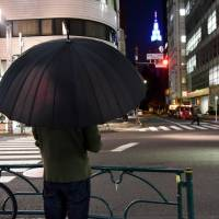 'I feel as if I'm living a lie,' says 'CW,' owner of a bar in Shinjuku Ni-chome. 'However, I don't want to be seen as 'the gay guy.' I want to be seen for who I am — without any gay filters.' | SATOKO KAWASAKI