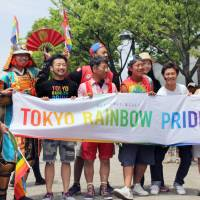 Taking a stand: Thousands of people march through Tokyo's Shibuya district in May 2017 to raise awareness of issues surrounding the LGBTQ community. Despite the advances in awareness in recent years, many in the LGBTQ community continue to face difficulties. | KYODO