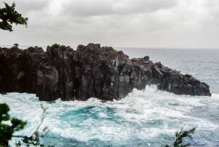 Rugged rocks: A torrid sea crashes against the jagged cliffs that jut out into 	Sagami Bay, Shizuoka Prefecture.