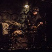 Behind the black curtain: A drummer sits behind layers of fabric during a performance of Koshiro Hino's 'Geist.' | ERIK LUEBS