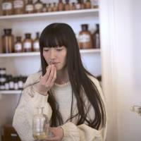 Hori checks aromatherapy oils at her boutique in Berlin. | DANIEL KULA