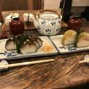 Roll up, roll up: Izuu specializes in saba-zushi (left), cured mackeral pressed into vinegar-flavored rice and wrapped in a piece of konbu seaweed.
