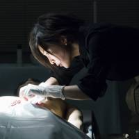 On the case: Yuko Takeuchi takes on the role of a modern-day Sherlock Holmes in the Hulu/HBO Asia series 'Miss Sherlock.'   ©2018 HJ HOLDINGS, INC & HBO PACIFIC PARTNERS, V.O.F
