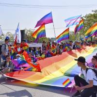 More than 20,000 people take part in a 'Rainbow Marathon' to raise awareness about LGBTQ issues in Nanjing, China, on April 15. | AP