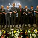 Trans-Pacific Partnership Minister Toshimitsu Motegi (fourth from right) and officials from 10 other nations join hands after the signing ceremony for the CPTPP in Santiago on March 8. Japan played a leading role in forging the TPP 11 deal.